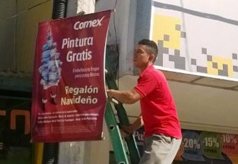 Desconocen comerciantes ley de pago para publicitarse en la Cuenca