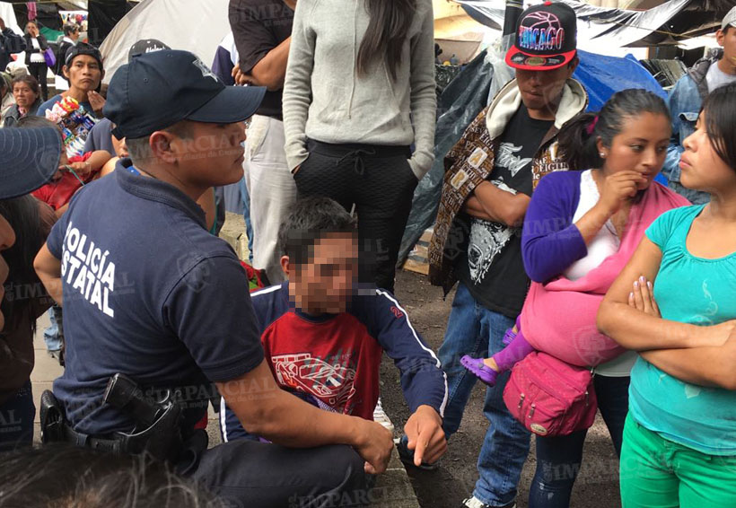 Detienen a dos menores de edad en el Zócalo de Oaxaca por supuesto robo de 11 mil pesos | El Imparcial de Oaxaca