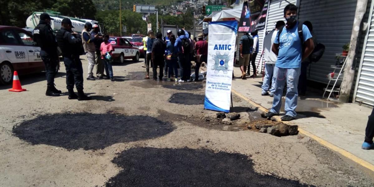 Suspenden trabajos de bacheo que realizaba la AMIC | El Imparcial de Oaxaca