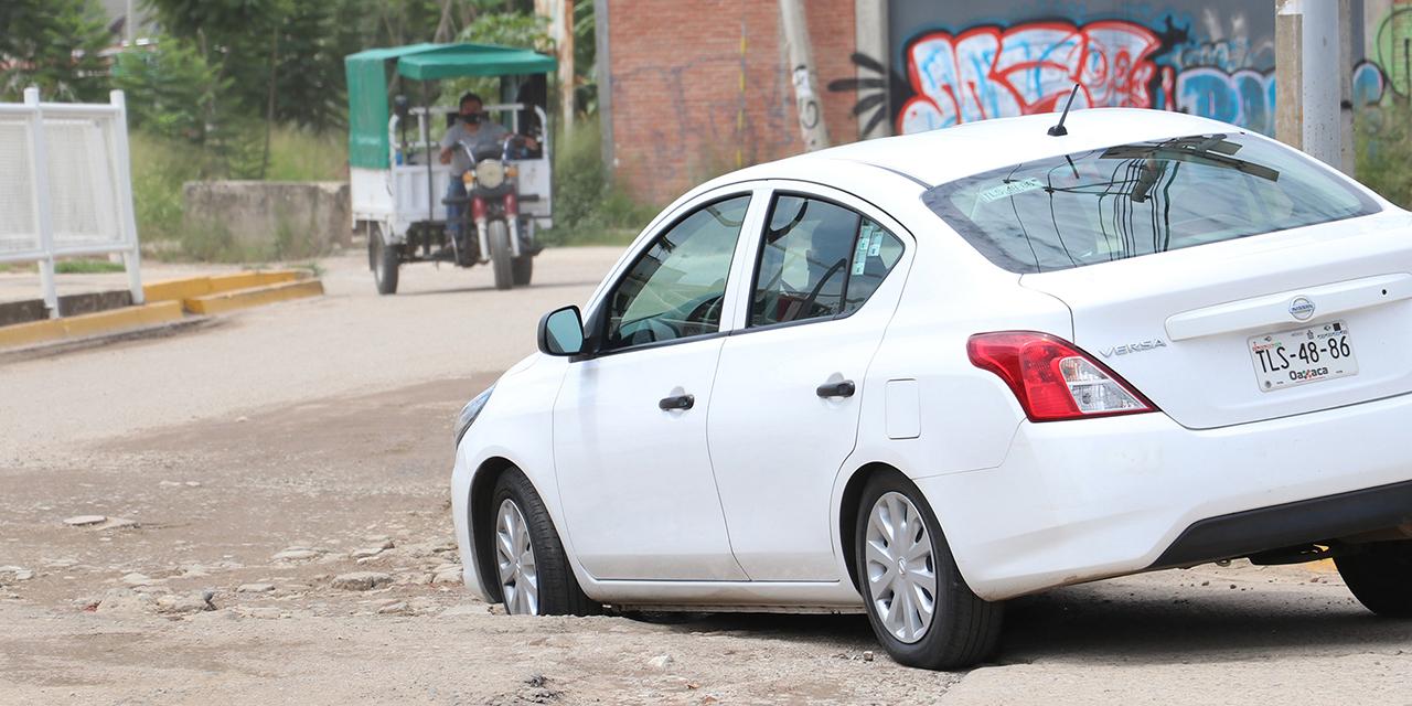 Conductores, indefensos ante daños por baches en la capital   El Imparcial de Oaxaca